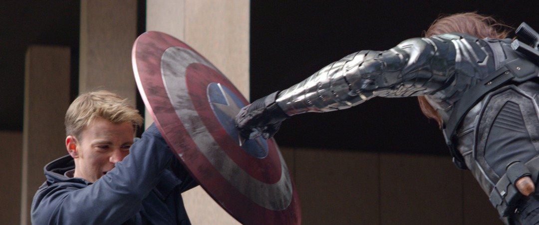 Captain-America-The-Winter-Soldier-Official-Photo-Bucky-punching-Shield